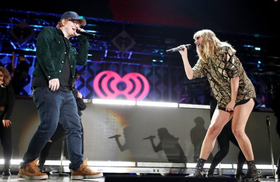 TAYLOR SWIFT AND ED SHEERAN performs onstage during 102.7 KIIS FM's Jingle Ball 2017 Presented by Capital One at The Forum on December 1, 2017 in Los Angeles, Ca. (Photo by Kevin Mazur Getty Images for iHeartMedia)